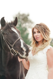Rustic bride portrait with black horse