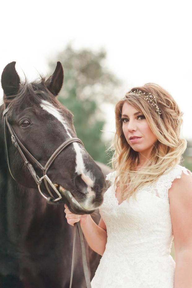 Rustic bride portrait with black horse